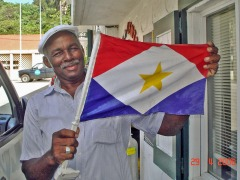 Taxi Driver #2  - Shows me a  Saba Flag