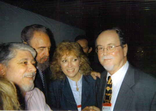 Will Johnson shaking Fidel Castro's hand, with Brazilian Minister of Education in between. Nov 16th 2002