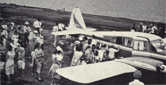 Sabans show their appreciation and great interest in twin-engine Apache's first landing on Saba's newly constructed airfield - Feb 1 1963
