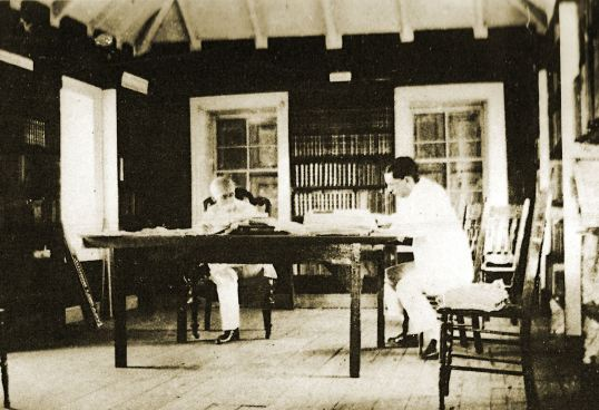 Arthur Valk in back with Irvin Mussenden in the library