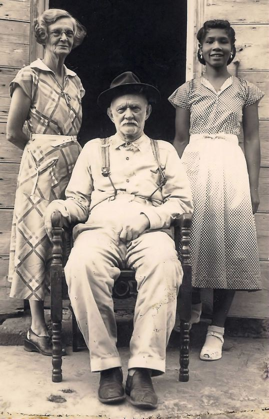 Edward Simmons who gave the land to have the church built on, here with his sister Annie Simmons-Pamenter and a Maid
