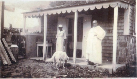 Father Wahlen and EllaRoosberg in Rectory kitchen in Windwardside.