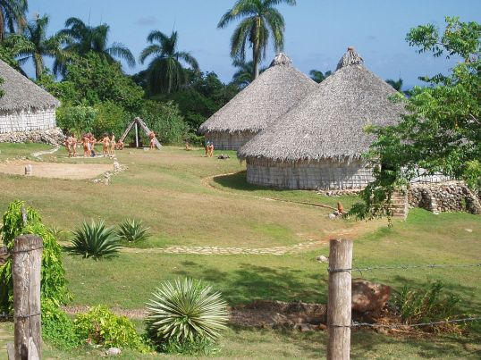 1200px-Reconstruction_of_Taino_village_Cuba