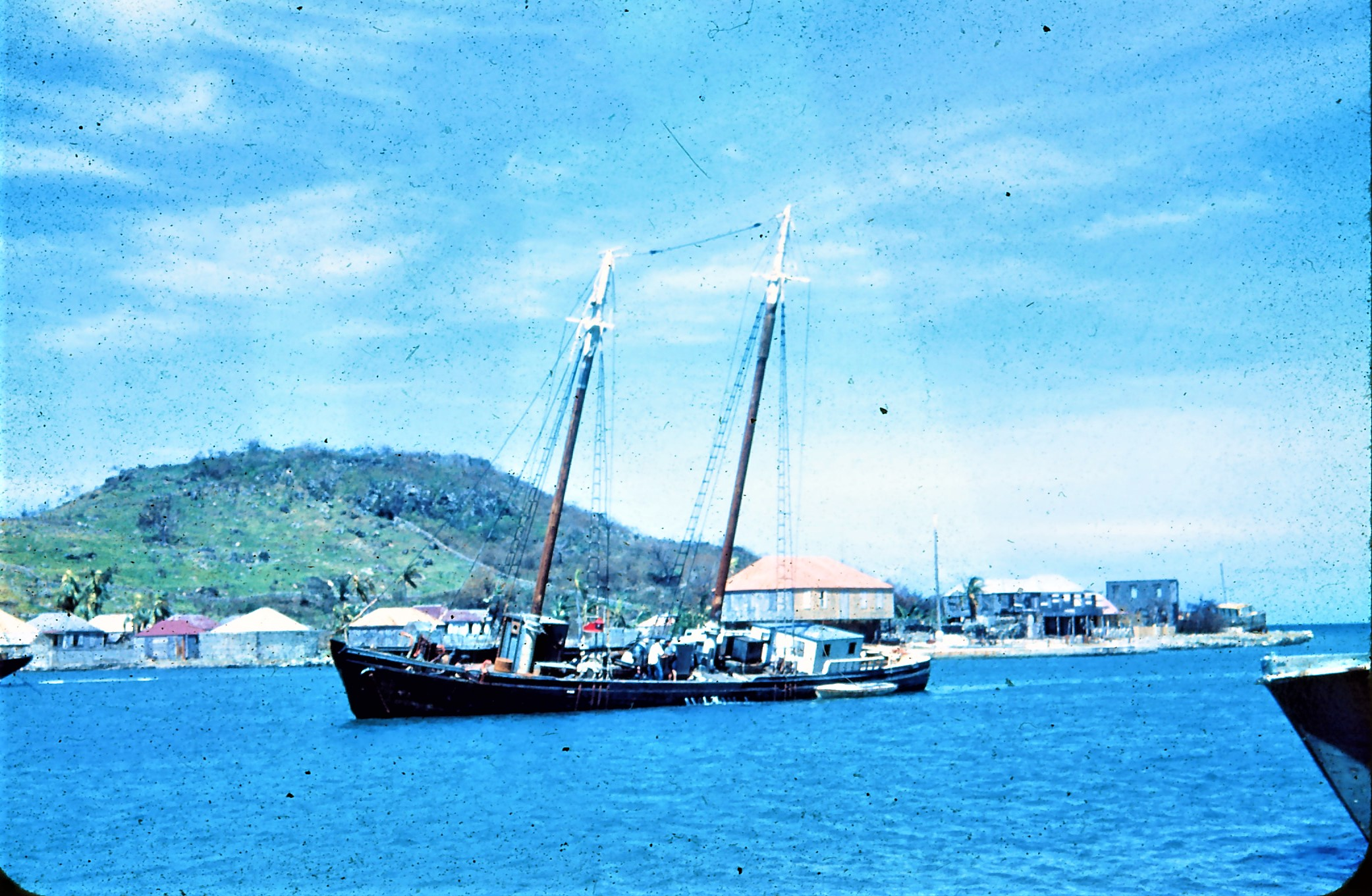 Schooner Roma with Charles Thomas Barnes' home in background.